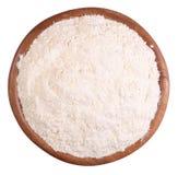 White flour in a wooden bowl on a white Stock Photo