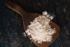 White flour on a wooden paddle Royalty Free Stock Images