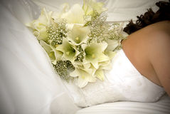 White flower bouquet on back of bride's back Stock Photo