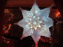White flower Christmas tree topper. White Christmas tree star or flower topper Royalty Free Stock Image