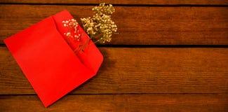 White flower in envelope on wooden plank Royalty Free Stock Image