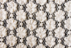 White Flower Knitting Pattern on Black Fabric Texture Background Royalty Free Stock Photography