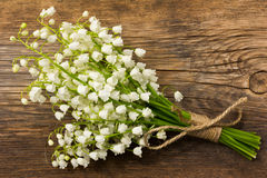 White flower lily of the valley on a background of old gray barn boards Royalty Free Stock Photos