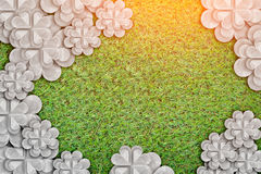 White flower paper cut on green grass background. White flower paper cut on green grass texture background Stock Image