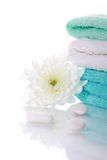 White flower with stones and towels Royalty Free Stock Photos