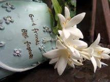 White flower in vase with Good friend are forever sign. White flower in sweet blue garden bucket Stock Photos