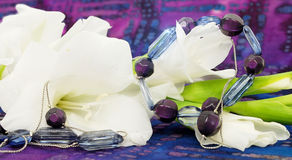 Free White Flowers And Purple Jewelry. Royalty Free Stock Photo - 21431445