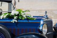 White flowers bouquet on a old car Royalty Free Stock Photos