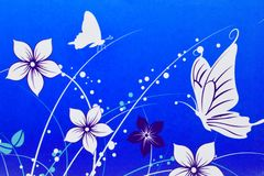 White flowers and butterflies drawn on blue background royalty free stock photos