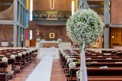 White flowers in church Royalty Free Stock Images