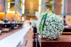 White flowers in church Royalty Free Stock Photos