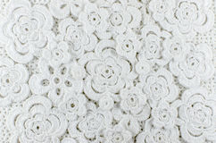 White flowers crocheted of wool Royalty Free Stock Photos