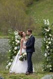 White flowers decorations during outdoor wedding ceremony Royalty Free Stock Photo