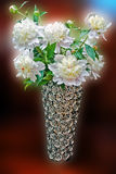 White flowers in decorative vase. Beautiful bouquet of white flowers in glamourous vase made from ceramics and glass Stock Photography