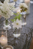White flowers on gray table cloth Royalty Free Stock Photography