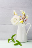 White flowers in jug. Roses in jug. Royalty Free Stock Photos