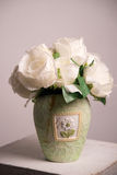 White flowers in the light green vase Royalty Free Stock Photos