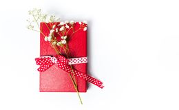 White flowers on red present box. Isolated top view royalty free stock photos