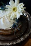 White Flowers on Round Cake With White Cream stock images