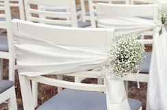 White flowers, Rustic Chic outdoor chair wedding decoration Royalty Free Stock Photography