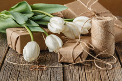 White flowers tulip on present box on table stock images