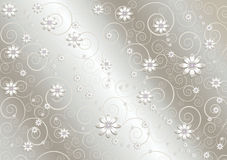 White flowers and twisted lines on  satin gray background. Delicate white flowers and twisted lines on undulating satin gray background Royalty Free Stock Photos
