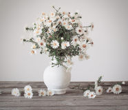 White flowers in vase. On table Stock Images