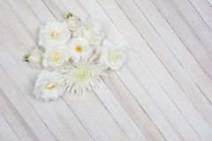 White Flowers on White Wood Table Stock Image