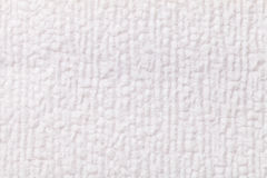 White fluffy background of soft, fleecy cloth. Texture of textile closeup. Stock Photos