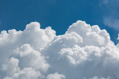 White fluffy big clouds against sky stock photography