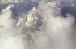 Mass of billowy white clouds against a blue sky. White, fluffy and billowing clouds create dreamy, heavenly atmosphere Stock Photo