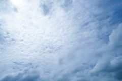 White fluffy cloud with dark blue sky with sunlight Royalty Free Stock Photo