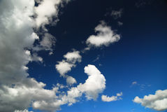 White fluffy clouds with background blue sky Stock Images
