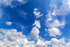 White fluffy clouds with the beautiful blue sky background Royalty Free Stock Photo