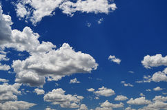 White fluffy clouds in a blue sky Royalty Free Stock Photos
