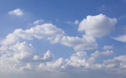 White fluffy clouds and blue sky Royalty Free Stock Photos