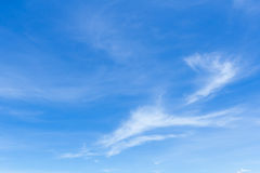 White fluffy clouds in the blue sky.  Stock Images