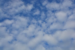 White fluffy clouds Stock Photos