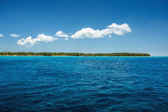 White fluffy clouds blue sky above a surface of the sea Royalty Free Stock Images
