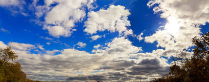 White fluffy clouds in the blue sky. Autumn sky clouds Stock Photography