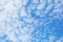White fluffy clouds in blue sky background. Summer cloudy day royalty free stock photography