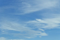 White fluffy clouds in the blue sky Stock Images