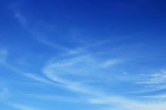 White fluffy clouds in the blue sky Stock Image