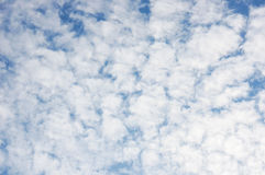 White fluffy clouds in the blue sky background Stock Image