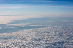 White, fluffy clouds in blue sky. Stratosphere. White, fluffy clouds in blue sky. Background from clouds. View from the aircraft on the Earth Royalty Free Stock Photography