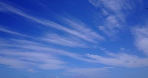 V10264 white fluffy clouds on blue sky background with drone aerial flying view on sunny summer day stock footage