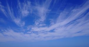 V10252 white fluffy clouds on blue sky background with drone aerial flying view on sunny summer day stock video