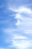 White fluffy clouds in the blue sky. Beautiful white fluffy clouds in the blue sky Royalty Free Stock Photography