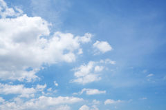 White fluffy clouds in the blue sky. Beautiful white fluffy clouds in the blue sky Royalty Free Stock Photo