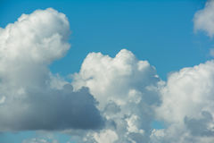 White fluffy clouds in blue sky. Close up detail of white clouds in the bright blue sky Stock Photo